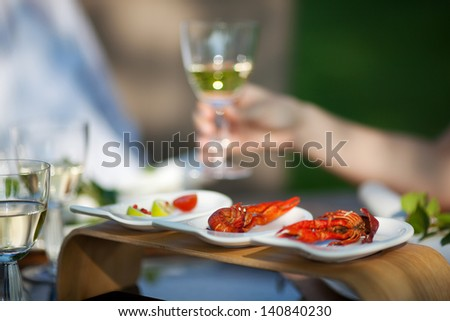 Closeup of crawfish on dining table outdoors - stock photo