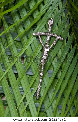 closeup of crucifix on palm leaves - palm sunday