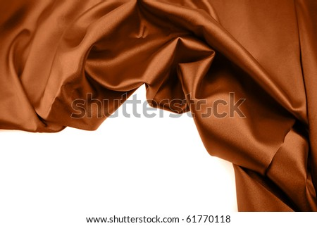 Closeup of crumpled brown silk fabric over white - stock photo