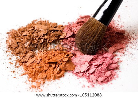 Closeup of crushed blush on white background and cosmetic brush - stock photo