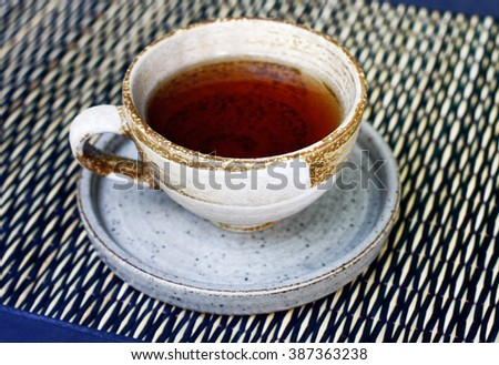 Closeup of cup of tea on mat.still life with tea cup.
