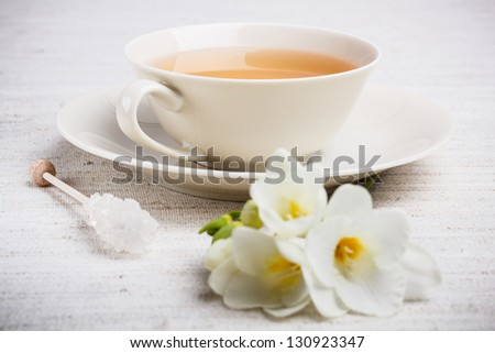 Closeup of cup of tea with freesia