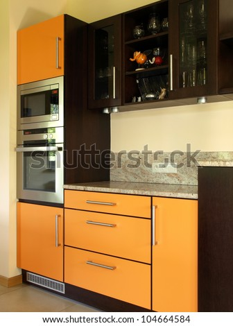 Closeup of cupboards and kitchen appliances, vertical - stock photo