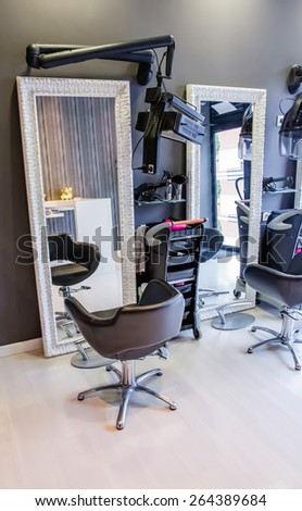 Closeup of customer seat inside of empty modern hair and beauty salon - stock photo
