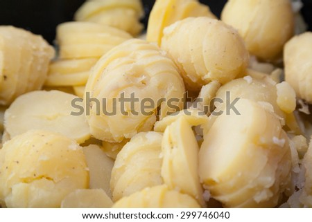 Closeup of cut boiled potatoes with selective focus - stock photo