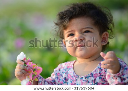 Closeup of cute adorable mixed race baby with innocent expression - stock photo