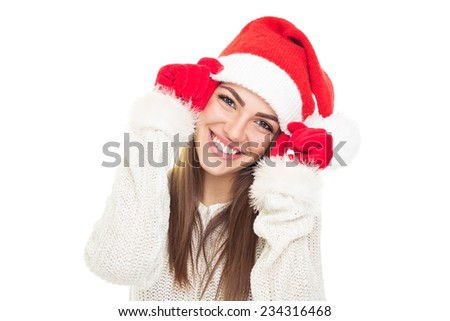 Closeup of cute young woman with Christmas hat smiling. Head shot of gorgeous Caucasian young brunette woman with Santa Claus hat. Isolated on white background. - stock photo