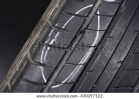 closeup of damaged car tire (studio shot)