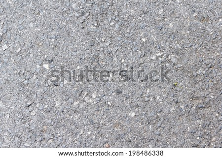 Closeup of Dark Asphalted Surface Background - stock photo