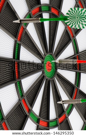 Closeup of dart board with darts. - stock photo