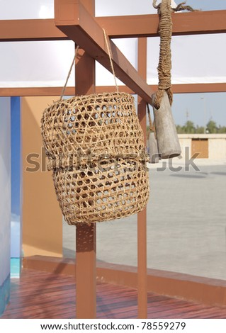 Closeup of date palm basket for storage of oyster and pearl molluscs - stock photo