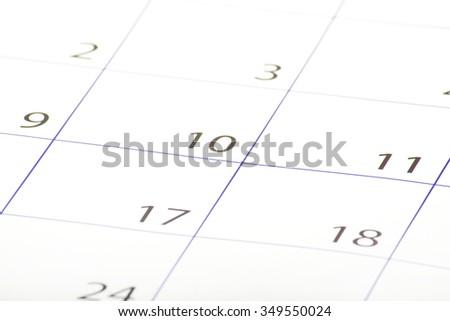 Closeup of dates on calendar page - stock photo