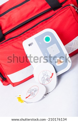 Closeup of defibrillator in first aid kit - stock photo