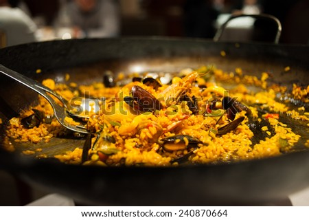 Closeup of delicious paella served in restaurant - stock photo