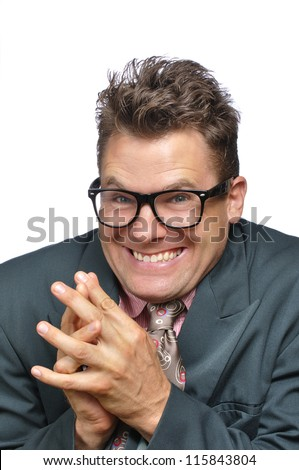 Closeup of devious excited nerd with a plan on white background - stock photo