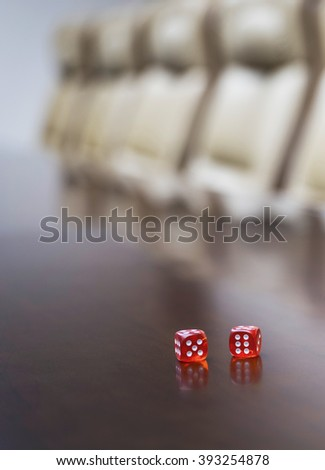Closeup of dices on table in empty corporate conference room before business meeting in office