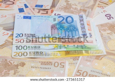 Closeup of different value euro banknotes background