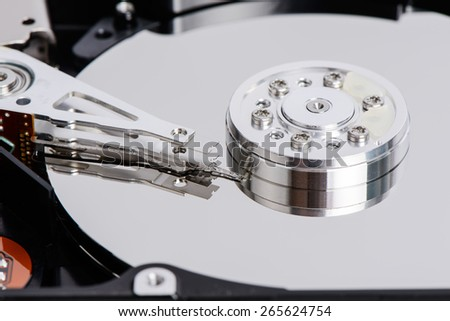 closeup of disassembled Hard disk drive. The images include Actuator Arm, head, Platter, Soindle and etc. - stock photo
