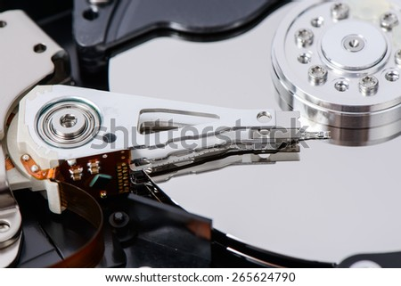 closeup of disassembled Hard disk drive. The images include Actuator Arm, head, Platter, Soindle and etc.