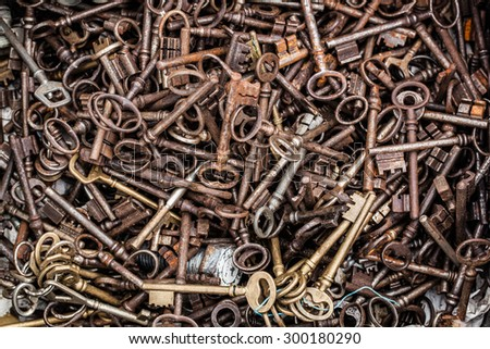 closeup of display of old rusted and brass keys in bulk for decoration or collection sold at flea market or garage sale for antique collection - stock photo