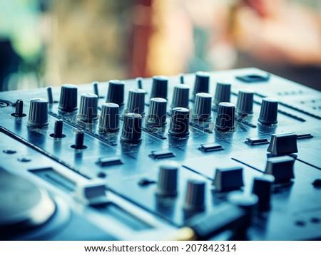 Closeup of dj controller with selective focus - stock photo