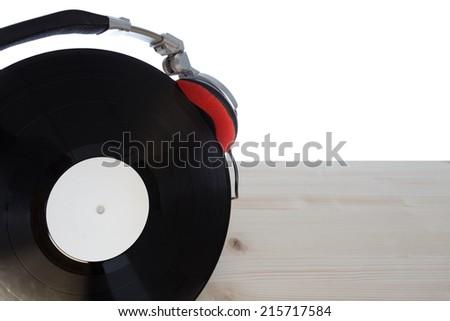 closeup of dj headphones on vinyl  - stock photo