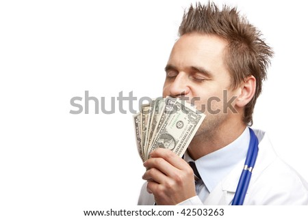 Closeup of doctor kissing a bundle of us dollar bills. Isolated on white. - stock photo