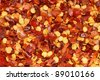 Closeup of dried hot chili flakes - stock photo