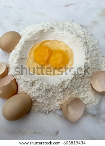 Closeup of eggs and wheat flour for preparing pastry