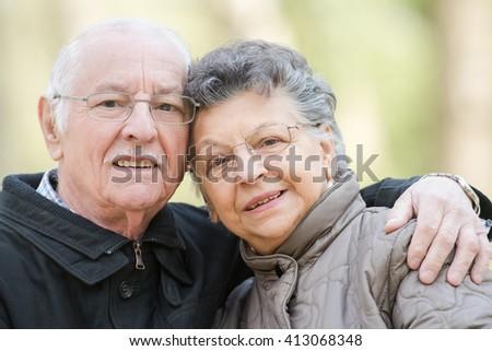 Closeup of elderly couple cuddling - stock photo