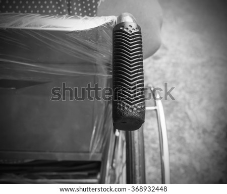 Closeup of elderly patient woman on wheelchair black and white.blur .