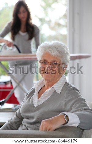 Closeup of elderly woman with home help