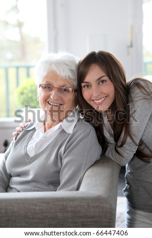 Closeup of elderly woman with young woman - stock photo