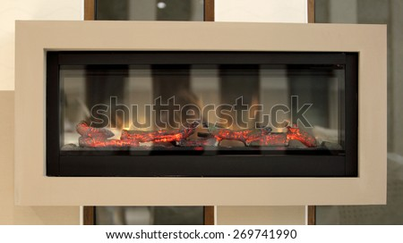 Closeup of electric artificial fireplace, modern interior background