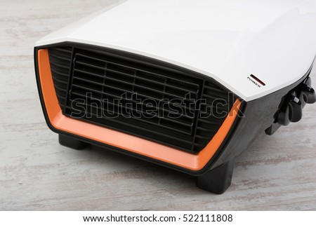 Closeup of electric heater on white laminate floor