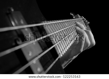 closeup of electrical guitar fingerboard, black and white