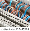 Closeup of electrical wires in switchgear cabinet - stock photo
