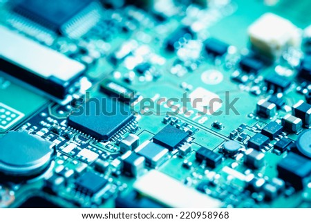 Closeup of electronic circuit board. - stock photo