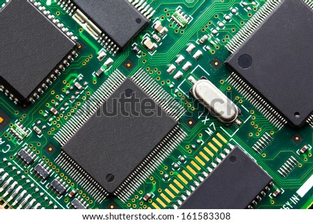 Closeup of electronic Circuit board with Microchips - stock photo