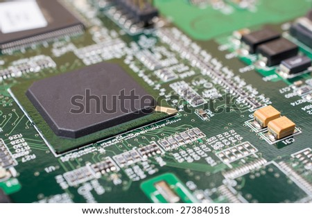 Closeup of electronic circuit board with processor. - stock photo
