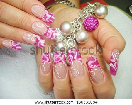 closeup of elegant see through pink abstract nail art design nails holding bracelet - stock photo