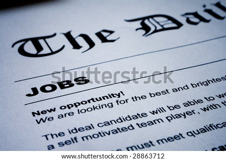 Closeup of employment classified ads on newspaper - stock photo