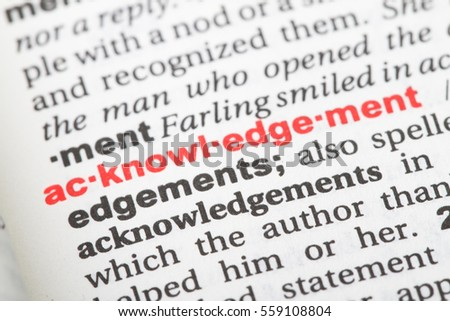 Closeup of English dictionary page with word acknowledgement.