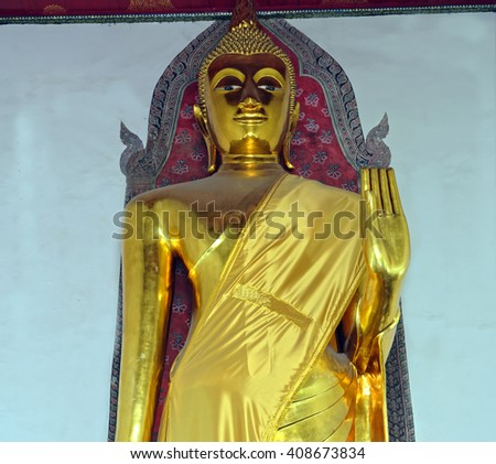 Closeup of enigmatic Buddha figure at the Wat Pho temple in Bangkok, Thailand