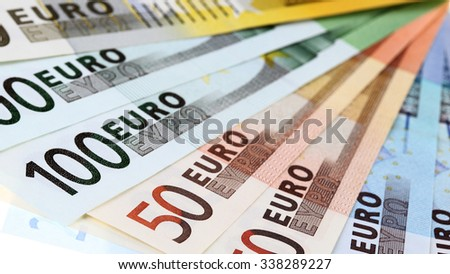 Closeup of euro banknotes, fan made of euro paper currency; isolated on white background
