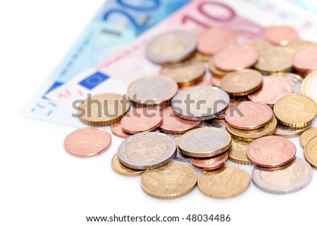 Closeup of European coins and banknotes isolated on white background