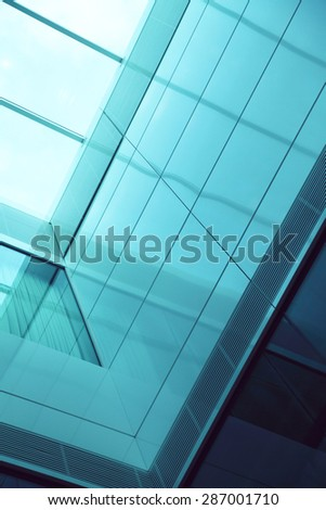 Closeup of exterior of glass residential building - stock photo