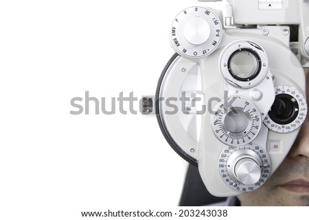 closeup of eyesight measurement with a optical phoropter - stock photo