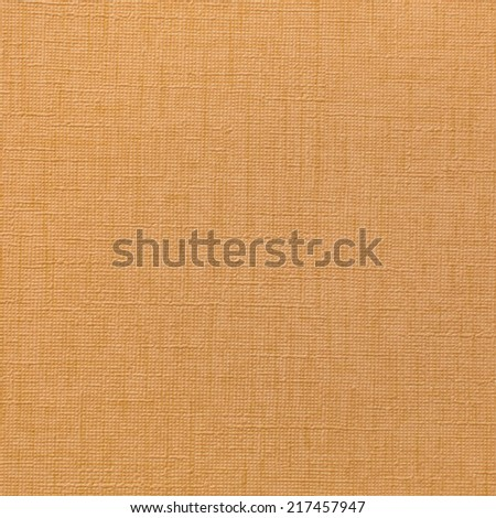 Closeup of fabric wallpaper texture in mastard color as background