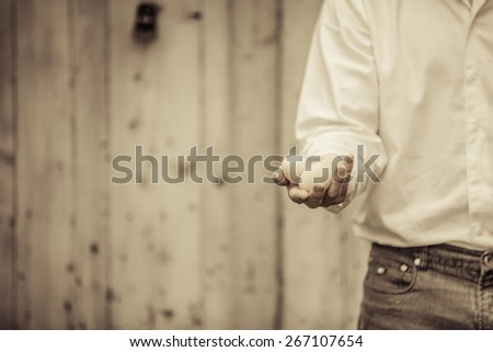 Closeup of Farmer Holding Eggs in front of a Farm - stock photo